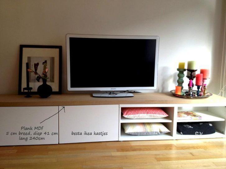 Leuk tv dressoir van Ikea Besta Kastjes en een MDF plank erop, zodat je de naden niet ziet.