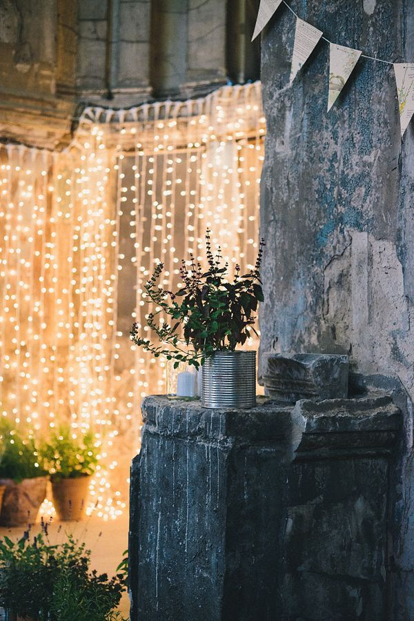 Curtain Lights are great for creating backdrops, especially outdoors against a concrete wall. You can hang sheer fabric over them for a soft glow #TwinklingWeddingLights  #Industrial #chic