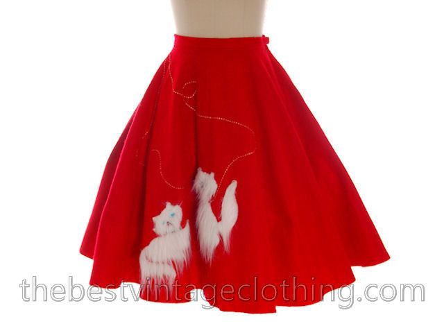 Adorable vintage circle skirt with white angora kittens playing on the front. They have blue jewel eyes and a pink jewel nose and red and gold rick-rack leashes. Button and zipper closure. No label, i
