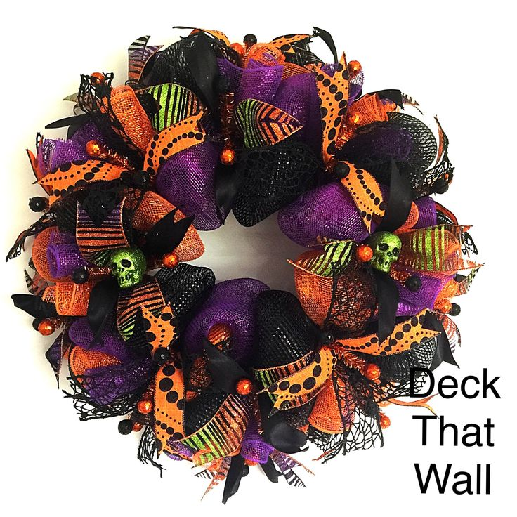This beautiful Halloween mesh wreath features three different colors of deco mesh as well as four different wired ribbons. Featured mesh is Orange Sparkle, Purple Sparkle, and Premium Black. The featu