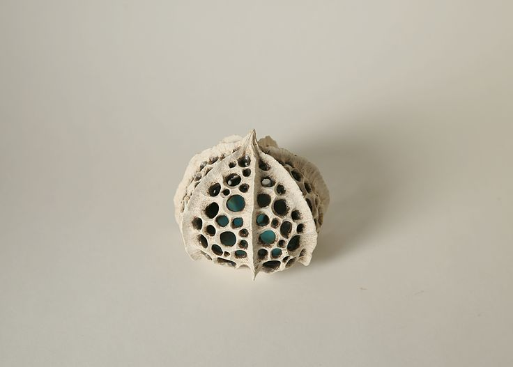 Skeleton Pod with blue glaze inside Handbuilt, carved clay, plankton, skeleton
