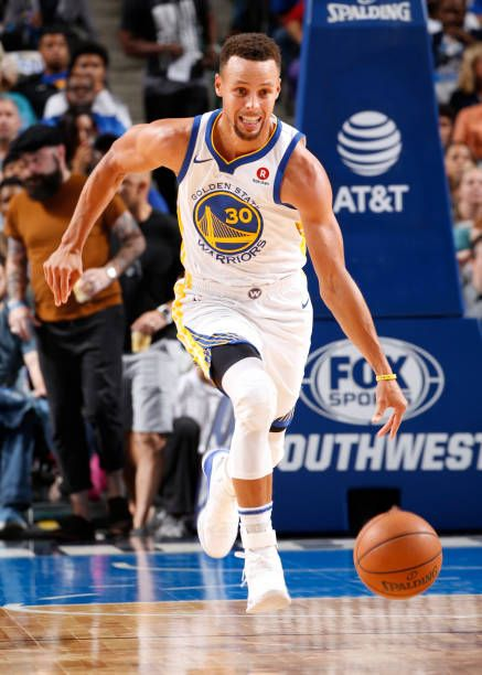 Stephen Curry of the Golden State Warriors handles the ball against the Dallas Mavericks on October 23 2017 at the American Airlines Center in Dallas...