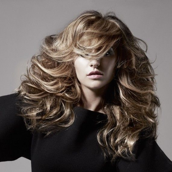 Big wavy hairstyle.    Create big, gorgeous waves for an evening out. For relaxed glamour, brush out ringlets after setting curls with a curling iron. Spritz a good dose of hairspray to hold the shape and use your fingers to tease your locks into this big and bouncy style.