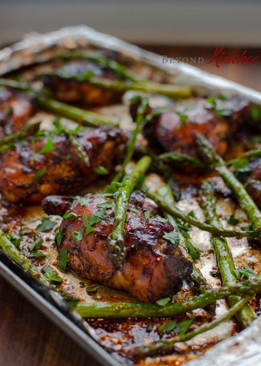 balsamic vinegar, soy sauce, garlic, and parsley will bring the finger licking good glaze on chicken thighs. And the asparagus is the bonus! All in one pan!