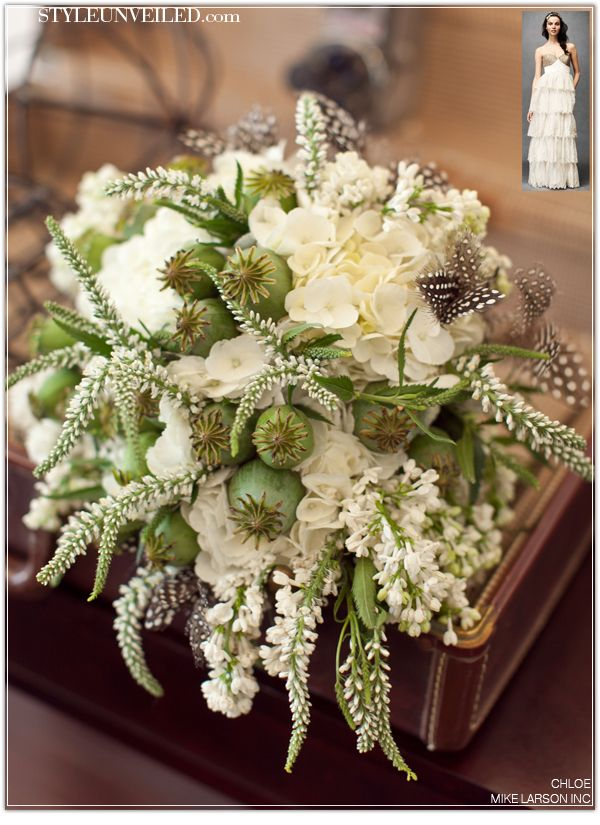 This gorgeous bunch of petals includes white lilac, hydrangea, white veronica, poppy pods, guinea feathers wrapped in antique lace & antique gold rhinestone trim