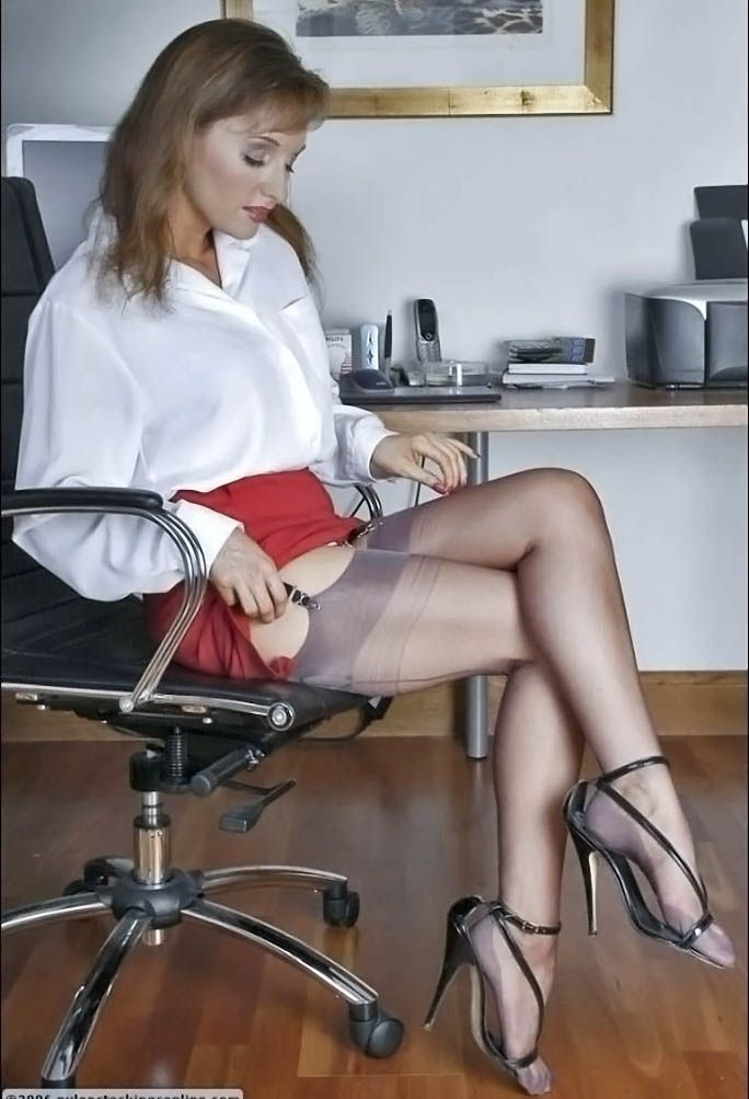 In the office playing with suspender straps wearing stockings and heels yum