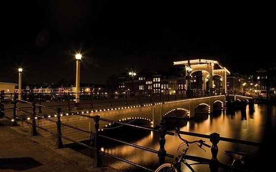 De Magere Brug: Photograph the most famous bridge in Amsterdam, lit up by more than 1,800 lights each night.