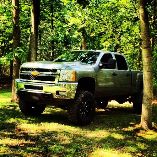 Brand new Chevy with a lift kit, look a hell of a lot better with you up in it :)