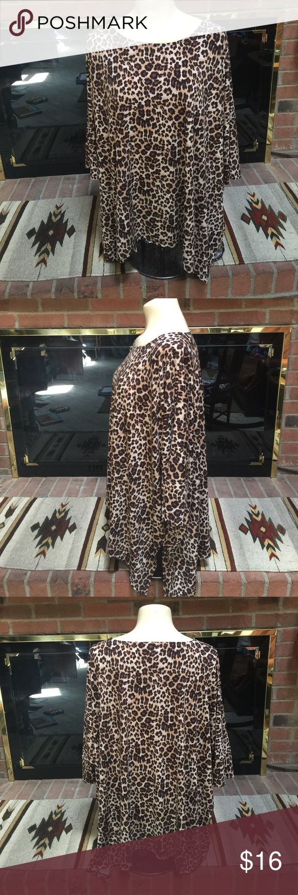 Chicos cheetah leggings top! Sz 2(oversized) Super cute-Great for leggings! I do believe this is a shark bite top, longer on the sides. I love the way the arms blend into the top. Gorgeous! Thanks! Chico's Tops Blouses