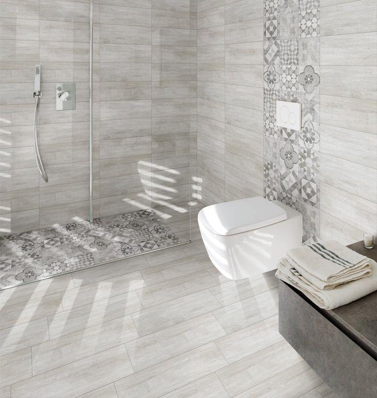 Une salle de bains avec des carreaux de ciment par touche