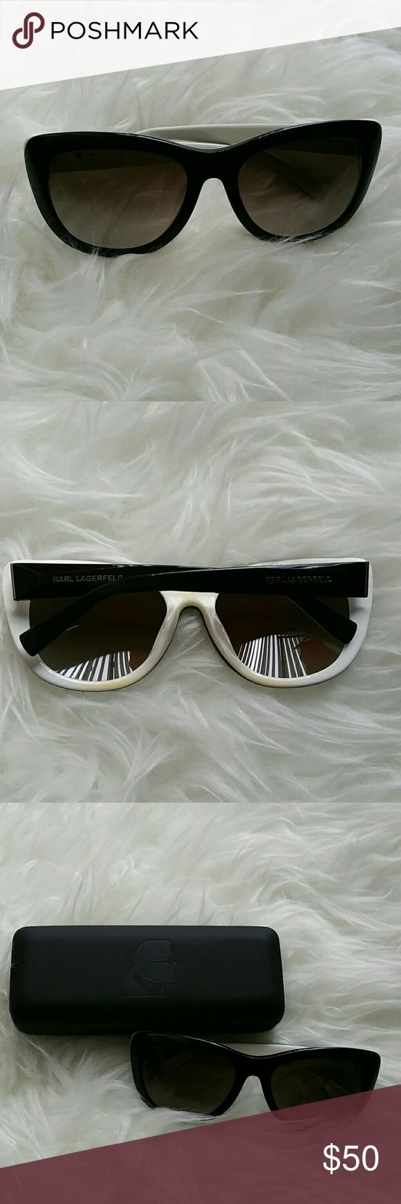Karl Lagerfeld sunglasses Cat/horn rimmed glasses. Very stylish. Note yellowish discoloration on the inside/white part due to makeup. Comes with original case. Very minor scratch on upper left corner of left lens, but vision and visibility not impaired. Pictures don't do these glasses justice. Karl Lagerfeld Accessories Sunglasses