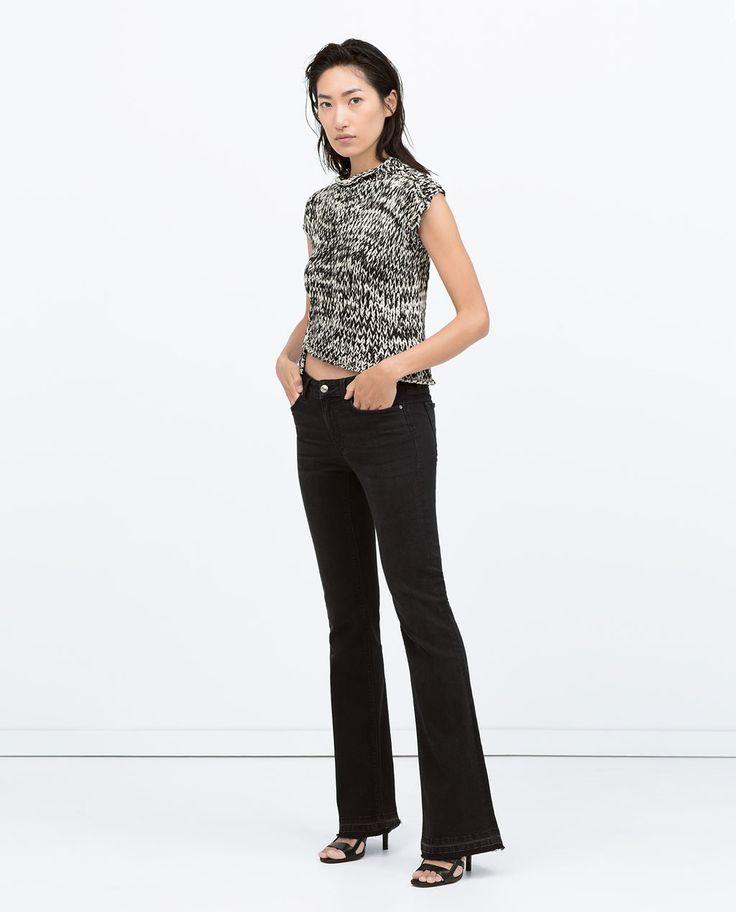 Bild 1 von DENIMHOSE SKINNY-FIT MIT BOOT-CUT UND LOW-RISE von Zara