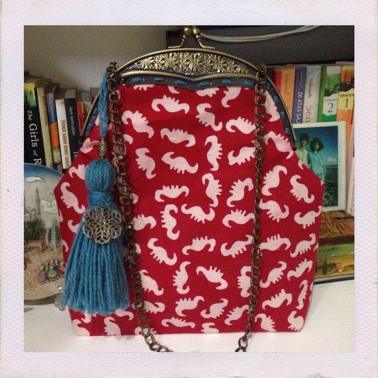 Red batik Garut frame bag with blue tassel