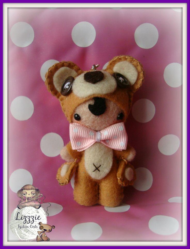 A small teddy bear doll...
