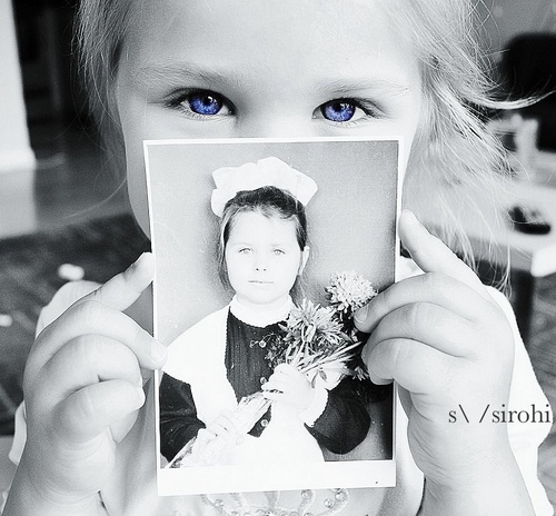 Holding her mom's pic when she was her age. Love making creative shots like this for a family portrait or kid's photo shoot.