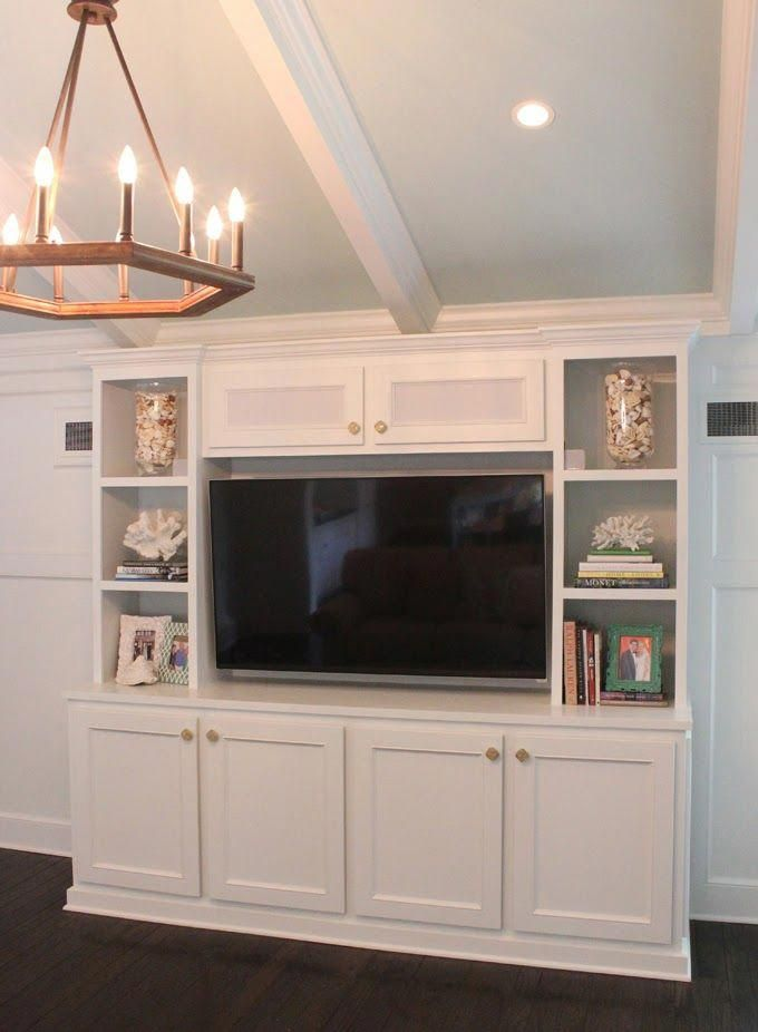 The White Woodwork And Cabinetry Combined With The Dark Wood