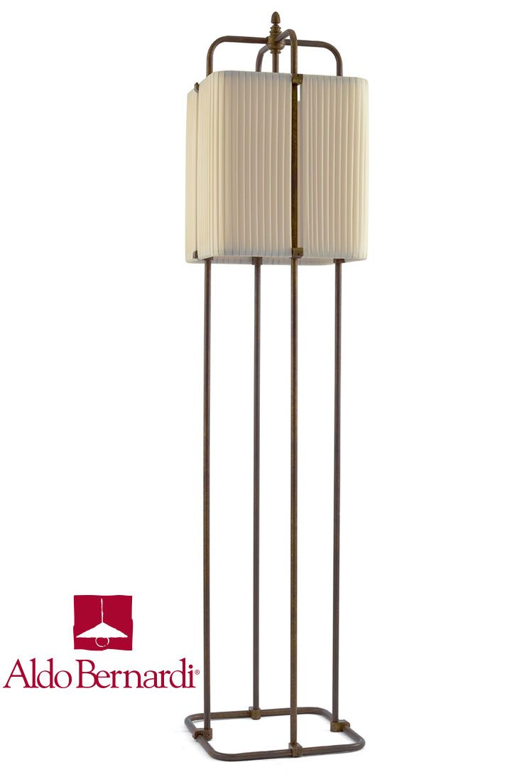 Vanavana four stems antique brass mobile lighting fixture on square base with single light and fabric shade fully integrated into structure. Tradition and innovation made in Italy by Aldo Bernardi.