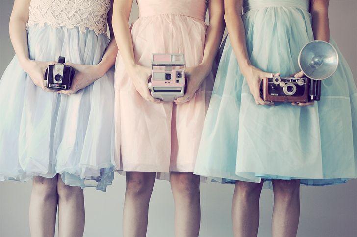 vintage dresses, vintage camera, pastels. pink, green, turquiose.