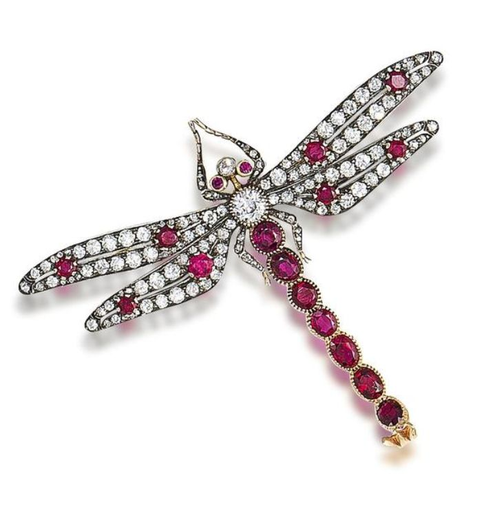A ruby and diamond dragonfly brooch  The body and wings set with old brilliant and rose-cut diamonds and circular-cut rubies, the abdomen with oval-cut rubies, mounted en tremblant, diamonds approximately 4.40 carats total, length 6.4cm, fitted case by Richard Digby, Sloane Street, London SW1. Victorian or Victorian style.: