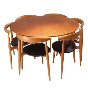 Dining set in teak and beech consisting of one table and 6 chairs.  Design by Hans J Wegner 1952  Produced by Fritz Hansen