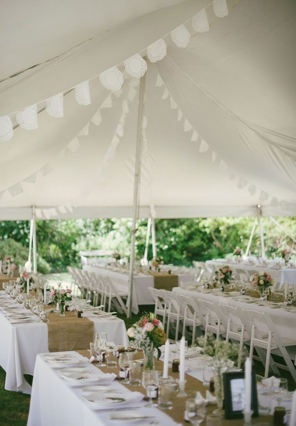 Great looking reception. The neutral table runner looks wonderful, and the white looks so fresh.