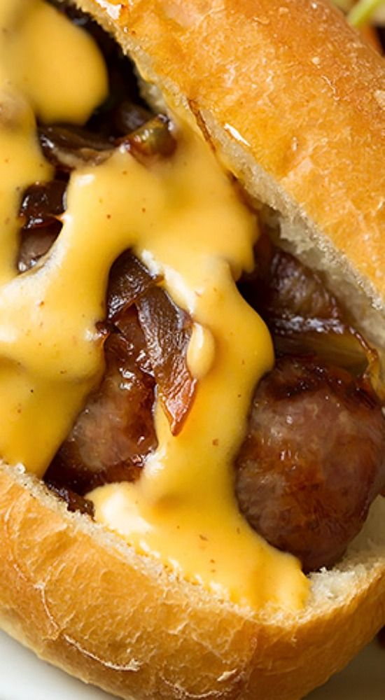 Brats with Caramelized Onions and Cheddar Cheese Sauce.