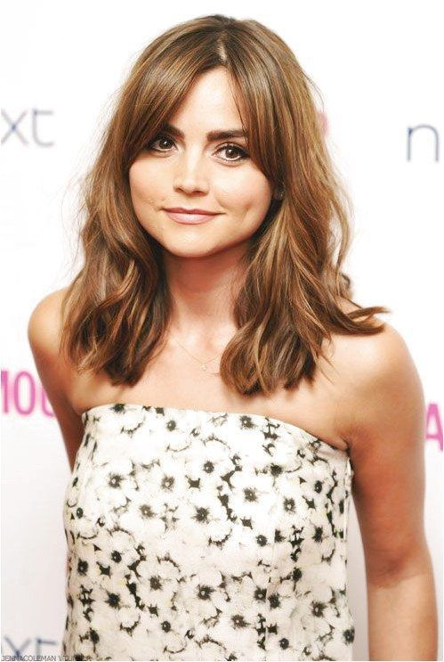 Jenna Coleman, hair out and wavy, slightly side parted long fringe, hair looks quite light here with quite a few highlights #StylesForWavyHair Click f
