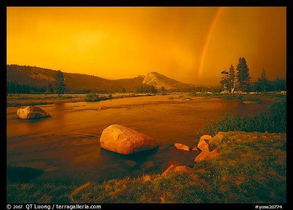 Tuolumne River, Lambert Dome, and rainbow, evening storm. Yosemite National Park, California, USA.