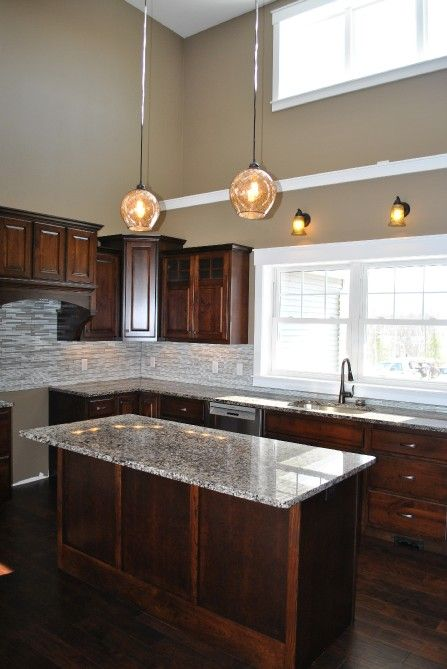 Dark Brown Kitchen Cabinets Granite Counter Tops White Trim Beige Paint Pantry Door Dark