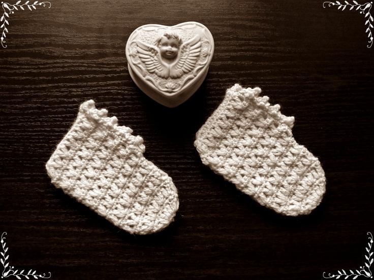 White crochet socks in a retro style.