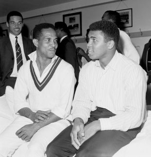 "A shot of Ali and Garry Sobers having a chat - ""The Greatest"" with the greatest allrounder.  Garry Sobers sits with Muhammad Ali in the dressing room, England v West Indies, Lord's, 1st day, June 16, 1966"