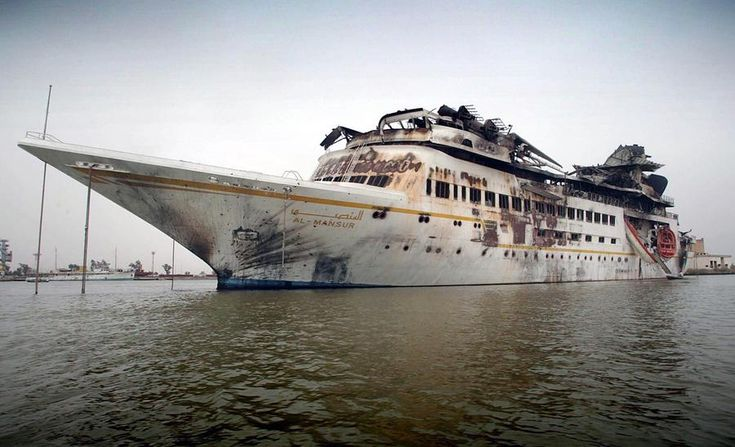"The damaged ""Al Mansur"", Iraqi President Saddam Hussein's private yacht, anchored in central Basra, on April 10, 2003. Photo by Simon Walker [OS] [900 × 547]."