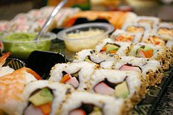 Sushi!  Not to make at home, but to eat out.  It's a fairly inexpensive lunch, and with salad and miso soup and tea it always feels like I've had a nice variety to eat.  This picture from Wikipedia emphasizes the rolls, I notice.