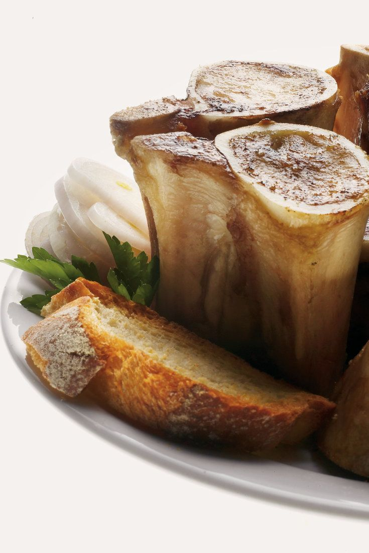 NYT Cooking: Spread onto toast with a spoonful of the parsley salad, the marrow is warm and fat and spiky from the peppery greens.
