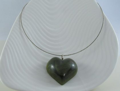 Green heart pendant created fem resin and steel wire.