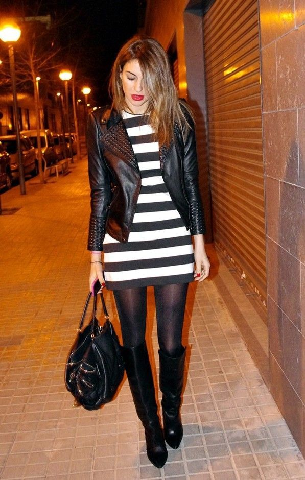Everything about this outfit is perfect! sexy rocker cool style. black leather jacket, black and white dress, boots and red lipstick.