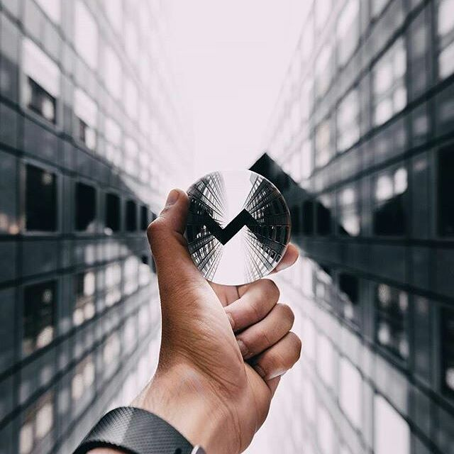 Modern architecture can be so fulfilling! A Lensball photo of a bridge between two skyscrapers. (photo by @urbandusk)