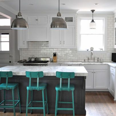 LOVE those stools! good example of brushed nickel pendants over island and glass pendant over sink...