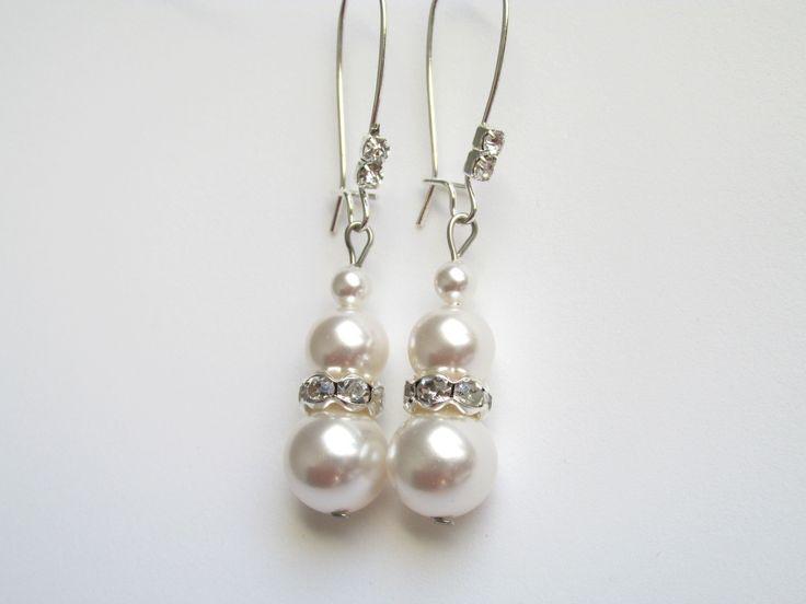 Swarovski Pearls earrings with silver plated rhinestones and crystals Cercei cu perle Swarovski si rhinestone placate cu argint si cristale Can be ordered here: https://www.facebook.com/handmadebutic