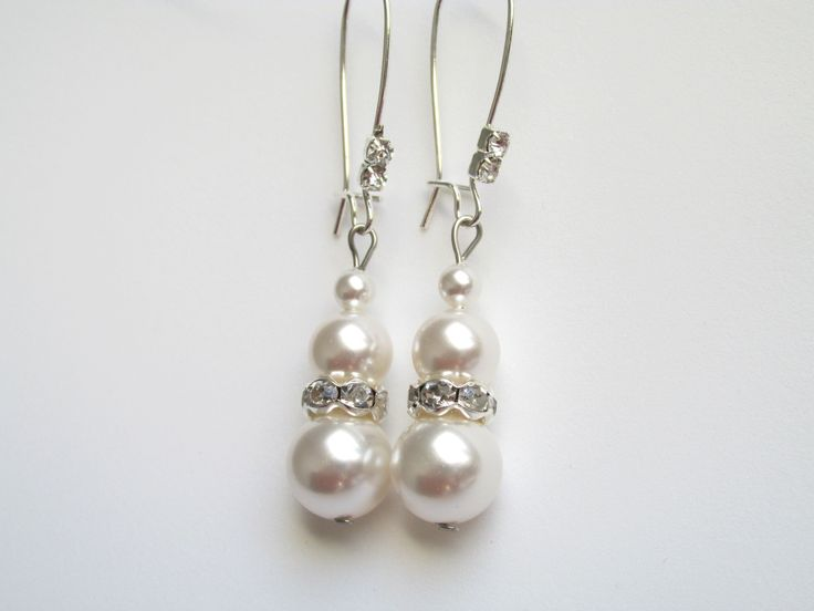Swarovski Pearls earrings with silver plated rhinestones and crystals Cercei cu perle Swarovski si rhinestone placate cu argint si cristale Can be ordered here: https://www.facebook.com/handmadebutic