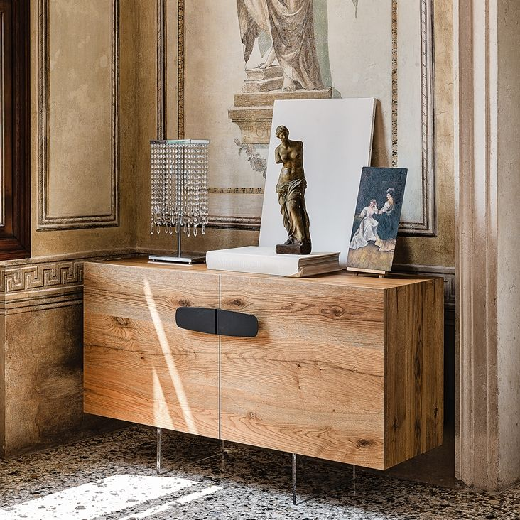 Nebraska sideboard by CATTELAN ITALIA  Sideboard with frame and doors in Canaletto walnut (NC) or Heritage oak (HR). Feet in transparent methacrylate. Internal clear glass shelves. Optional: 1 internal drawer in the central door of 3 version.    Optional Drawer 147€ http://www.format-store.com/en/prod/living-area/sideboard-and-container/nebraska-sideboard-by-cattelan-italia.html