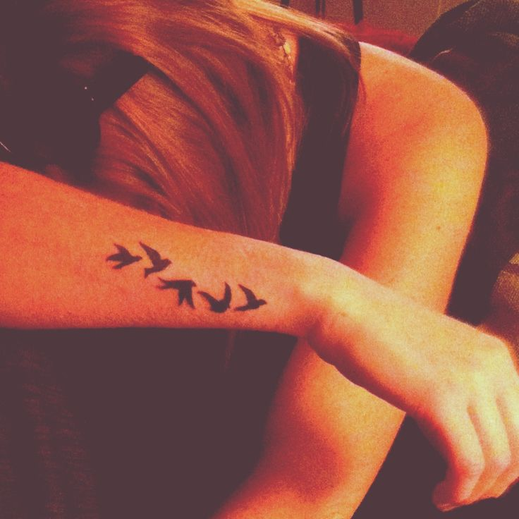 Bird wrist tattoo.