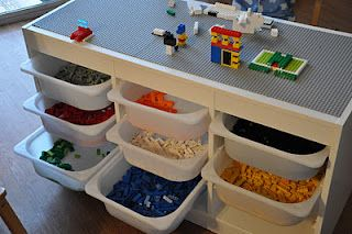 "Lego table made using Ikea's Trofast system.  Really like the clean look with white tubs and the idea of no lids on them....even better. Plus, bc each tub has it's spot to hang nice and straight, there is no chance them getting ""tidied up"" incorrectly! Yes!"