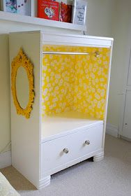 Kids storage unit- use an old dresser or storage cabinet. Paint it, line it with wallpaper, and add a rod to hang clothes on. Perfect!