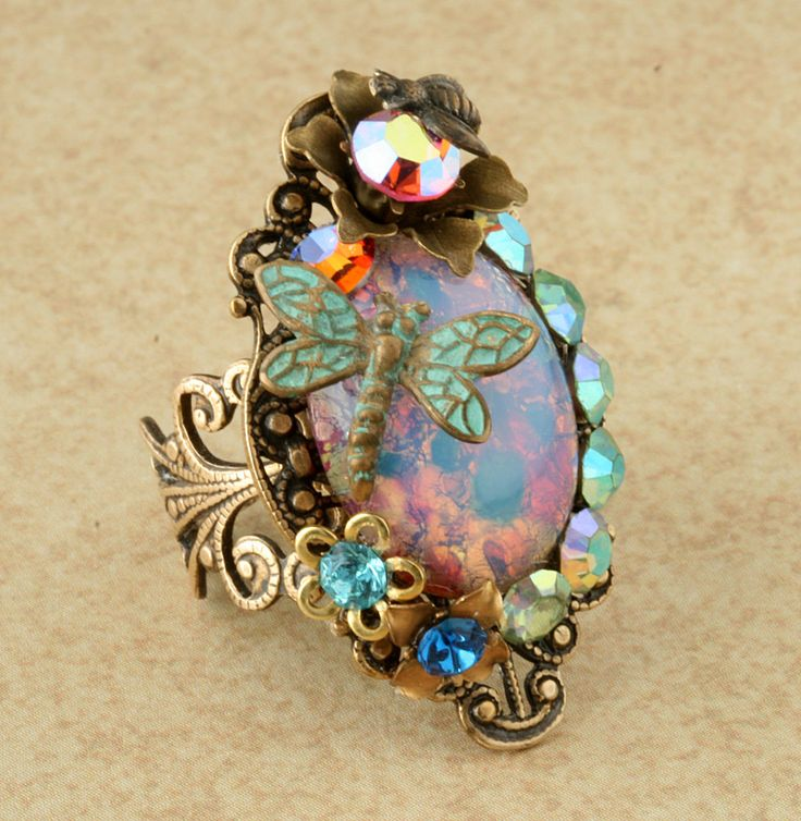 Pink Opal Ring Pink Harlequin Opal Ring Cocktail Ring Dragonfly Ring Opal Flower Bee Brass Filigree Victorian Ring Rhinestone Statement Ring. $65.00, via Etsy.