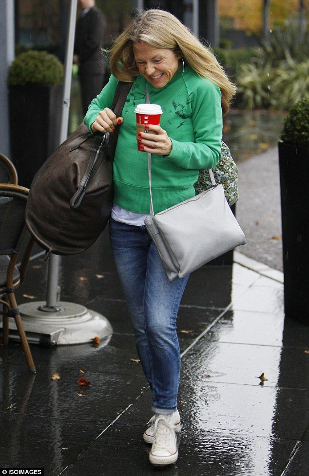 Not a fan of downpours: EastEnders actress Kellie Bright grimaced as she made a dash for it