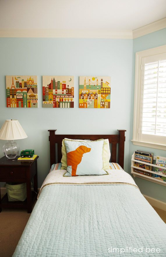 traditional boys bedroom in blue and orange