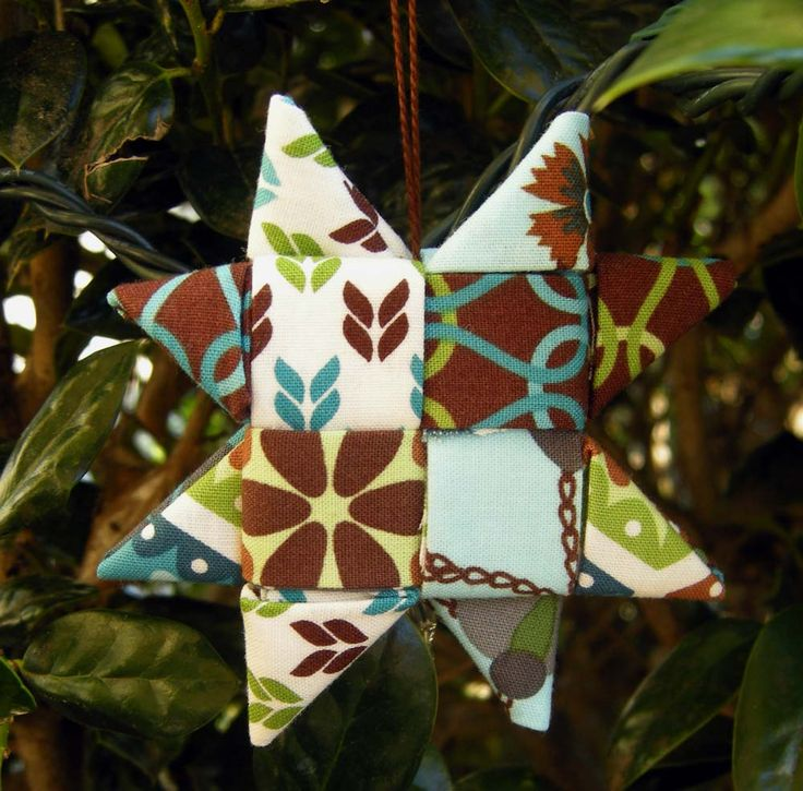Fabric Star Ornament Tutorial //Pretty awesome --These are simply woven from folded fabric! No complicated sewing.