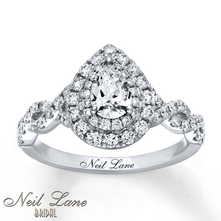 A pear-shaped diamond takes center stage, surrounded by two rows of dazzling round diamonds, as part of this elegant engagement ring from Neil Lane Bridal®. Ribbons of round diamonds weave together along the band, styled in 14K white gold. The ring has a total diamond weight of 1 1/8 carats, and Neil Lane's signature adorns the inside of the band. Diamond Total Carat Weight may range from 1.115 - 1.14 carats.