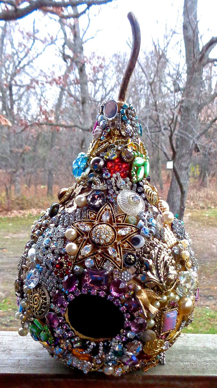 I covered a gourd with old jewelry and fancy buttons. Used E6000 glue. Fall 2014…